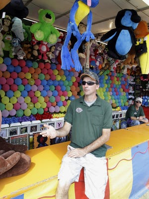 Game booths, like this one manned here last year by Dan Miller of Appleton, are regular staples at the Sheboygan County Fair, which opens Thursday, Sept. 3, in Plymouth.