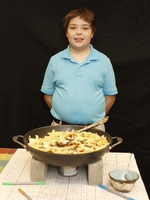 Ethan Morrow with Ethan's Cheesy Chicken Pasta with Mushrooms and Bacon.