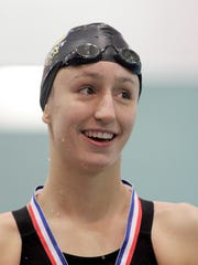 Mariemont's Cora Dupre smiles after winning the 200 yard freestyle.