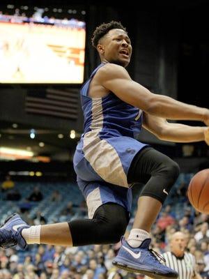 Summit's Xavier Johnson drives to the basket.