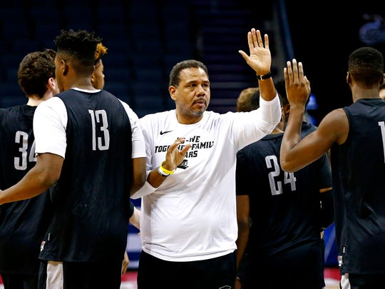 Providence coach Ed Cooley high fives his players during