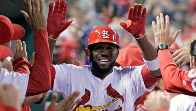 St. Louis Cardinals' Dexter Fowler celebrates with teammates after hitting a two-run home run in the third inning of a baseball game against the Cincinnati Reds, Friday, April 28, 2017, in St. Louis.