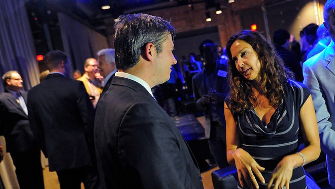 Ashley Judd talks with state Senate candidate Jeff Yarbro at a Wednesday evening fundraiser.