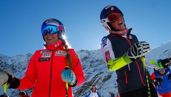 Lindsey Vonn, left, and teammate Mikaela Shiffrin stand