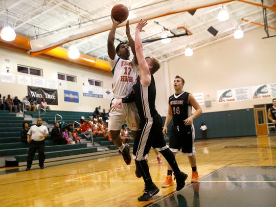 FAMU DRS' Khalil Butler tries to lay the ball up over Christ's Church Academy's Caleb Gay during their Regional Quarterfinal game on Thursday.