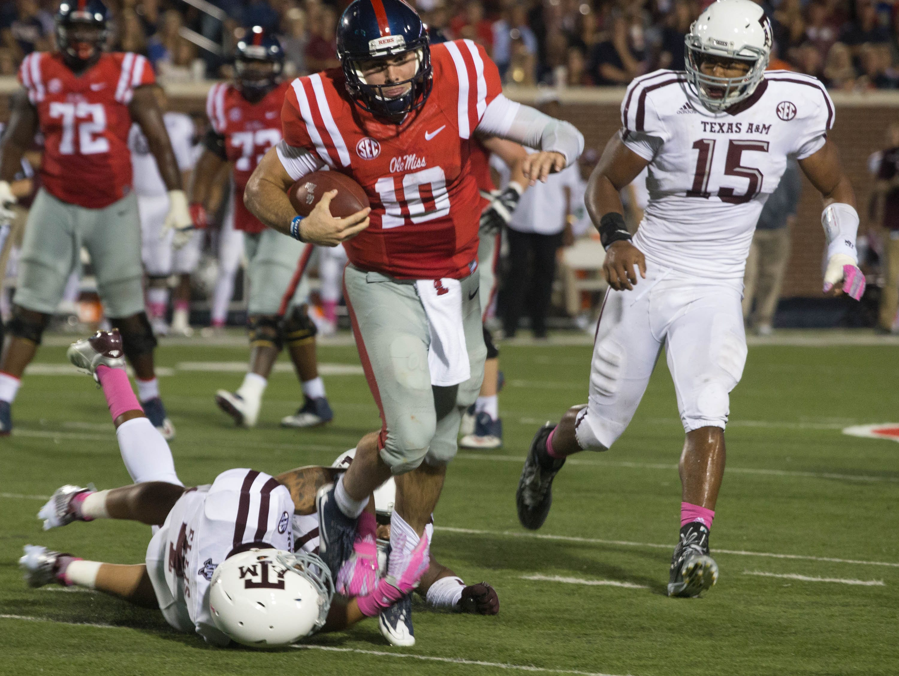 Chad Kelly jumps through a Texas A&M's Noel Ellis tackle on the option, for his longest gain of the first half, 13 yards.