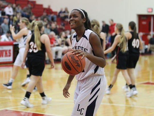 Lebanon Catholic's Neesha Pierre smiles while watching