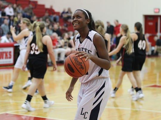 Lebanon Catholic's Neesha Pierre smiles while watching the clock run out at the end of the Beavers' 47-30 win over Tri-Valley in a PIAA Class A tournament second-round game at Hamburg Area High School on Wednesday.