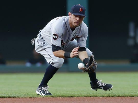 Tigers second baseman Ian Kinsler fields a ground ball
