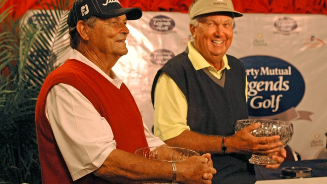 Jimmy Powell, left, and partner Al Geiberger hold their trophies after winning first place in the Liberty Mutual Legends of Golf Demaret Division at The Club at Savannah Harbor.