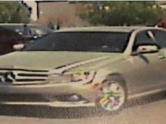 A security camera image shows a silver Mercedes police say was used by a robbery suspect Monday.