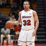 Marist College's Chavaughn Lewis competes against Manhattan on Monday at the McCann Arena.