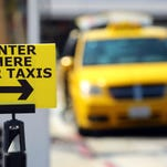A taxi waits for a passenger the Palm Springs International Airport taxi stand on Wednesday.
