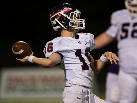 South-Doyle quarterback A.J. Nunn (16) attempts a pass during a game between South-Doyle and Sevier County on Thursday, Sept. 14, 2017.