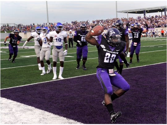 Abilene Christian University running back De'Andre Brown spikes the ball in the end zone Saturday, drawing a penalty but also making ACU's first touchdown in their new stadium Sept. 16, 2017. ACU defeated Houston Baptist, 24-3.