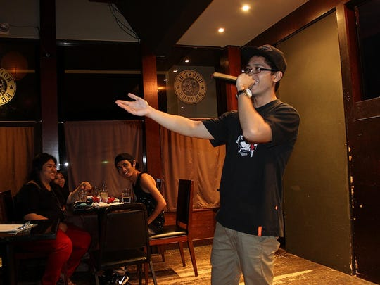 """John """"Meta"""" Sarmiento hosted Open Mic Poetry Night at House of Brutus on Jan. 22, 2014. Ashley Brown/For Pacific Daily News"""