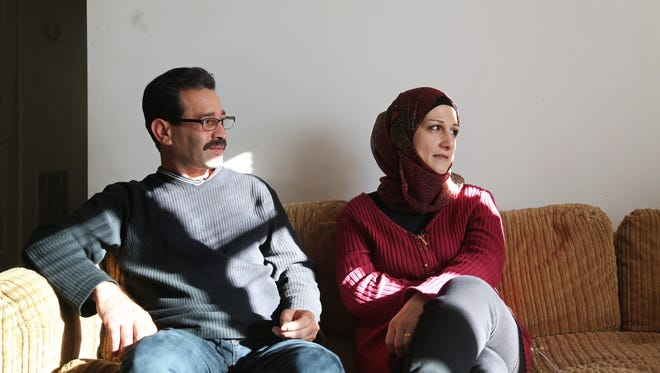 Abdul Tameem, 42, and Ghazweh Aljabooli, 35, sit together on a couch in their apartment on Monday, Nov. 14, 2016, in Des Moines. Abdul, Ghazweh and their five children were the first Syrian refugees to come to Des Moines.
