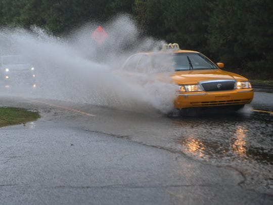 Cars move slowly through standing water on Civic Center Boulevard in Anderson on Monday.