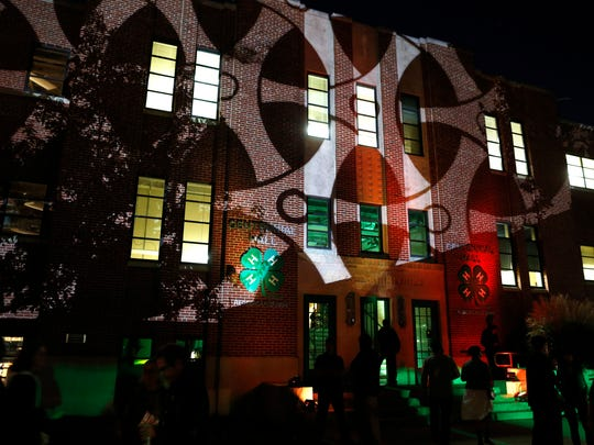 Centennial Hall is lit up during ORANJE art and music event showcasing progressive artists and musicians Saturday September 13, 2014 at the Indiana State Fairgrounds.