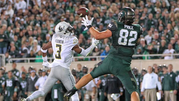 Sep 12, 2015; East Lansing, MI, USA; Michigan State Spartans tight end Josiah Price (82) attempts to catch a pass against Oregon Ducks safety Tyree Robinson (3) during the 2nd half of a game at Spartan Stadium. MSU won 31-28. Mandatory Credit: Mike Carter-USA TODAY Sports