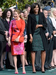 First lady Michelle Obama (R) and Sophie Gregoire-Trudeau,