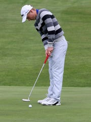 Trumansburg's Danny Lapp putts on the 18th hole Wednesday
