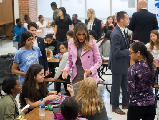 First lady Melania Trump chats with students in cafeteria