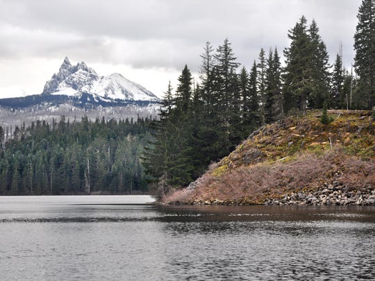 The rock peninsula is visible across Marion Lake, below Three Fingered Jack. This photo is from April in the low snow year of 2015.