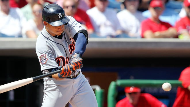 Detroit Tigers shortstop Jose Iglesias hits the ball into Philadelphia Phillies starting pitcher Miguel Alfredo Gonzalez, allowing Ian Kinsler to score from third base during the third inning.