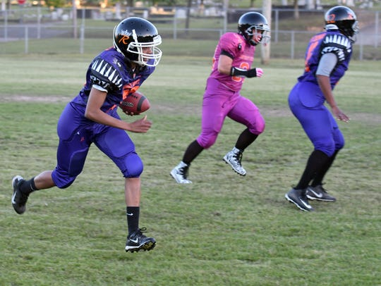 Latoya Brown runs the ball down the field as she practices