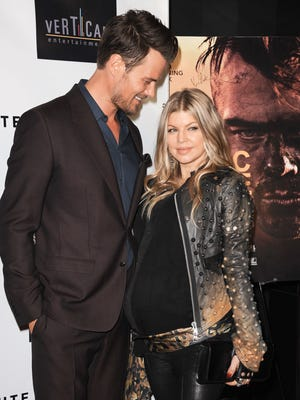 Josh Duhamel and Fergie arrive at the premiere of 'Scenic Route' at the Chinese 6 Theater Aug. 20 Los Angeles.