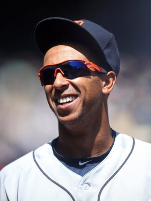 Apr 14, 2016; Pittsburgh, PA, USA; Detroit Tigers outfielder Anthony Gose (12) reacts in the dugout against the Pittsburgh Pirates during the third inning in an inter-league game at PNC Park.