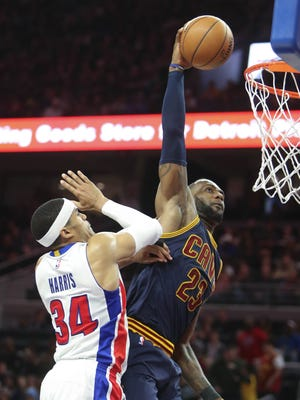 Pistons forward Tobias Harris can't prevent a dunk by Cavaliers forward LeBron James during the third quarter of the Pistons' 106-101 win Thursday, March 9, 2017 at the Palace.