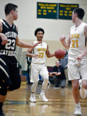 York Catholic's Eric Phelps looks to make a play against Delone Catholic in the second half of a YAIAA boys basketball game Friday, Jan. 5, 2018, at York Catholic. York Catholic defeated Delone Catholic 70-36.