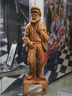 """This Canadian qualifier trophy, carved from wood, is Bobby Unser's favorite, seen at the Indianapolis Motor Speedway Museum's exhibit, """"The Amazing Unsers: From Albuquerque to Indianapolis,"""" Tuesday, April 10, 2018."""