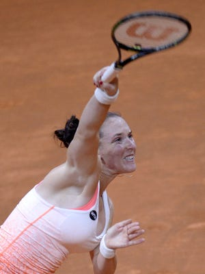 Madison Brengle of Dover serves to Caroline Garcia of France in their quarterfinal Friday at the WTA Porsche Tennis Grand Prix in Stuttgart, Germany.