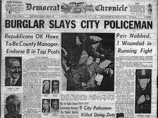 The Dec. 12, 1959, Democrat and Chronicle front page reporting that Rochester Police Officer Harold Shaw was killed by burglars. (From microfilm)