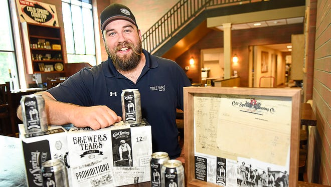 "Third Street Brewhouse Manager Karl Schmitz shows the brewery's newest beer, dubbed ""Brewer's Tears,"" Thursday, June 1 in Cold Spring. The pre-Prohibition recipe by brewmaster Eugene Hermanutz was recently found in an old file cabinet at the brewery."