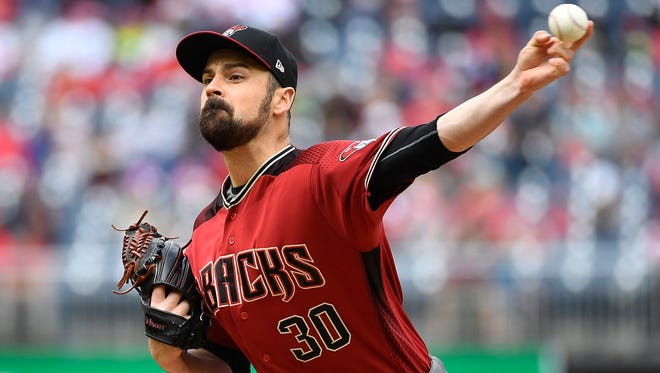Apr 29, 2018; Washington, DC, USA; Arizona Diamondbacks relief pitcher T.J. McFarland (30) throws against the Washington Nationals during the second inning at Nationals Park. Mandatory Credit: Brad Mills-USA TODAY Sports