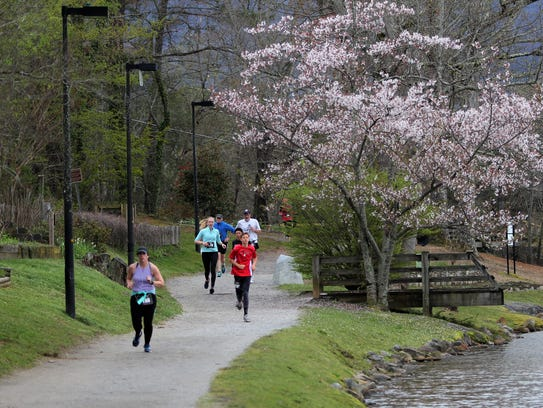 Runners made their way around Lake Tomahawk, the town's oldest and most widely used greenway.