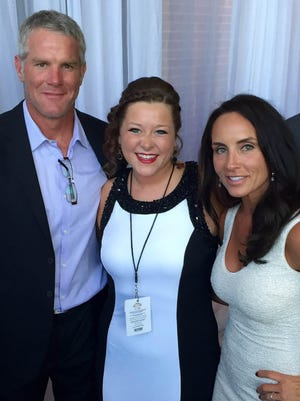 Bay Port High School graduate Maddie Forrest, center, got to meet Brett and Deanna Favre before singing the national anthem at his induction ceremony into the Packers Hall of Fame on Saturday night.