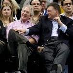 FILE - In this Feb. 19, 2012, file photo, Aubrey McClendon, left, CEO and chairman of the board of Chesapeake Energy Corp. and Clay Bennett, right, chairman of the ownership group of the Oklahoma City Thunder, watch during an NBA basketball game against the Denver Nuggets in Oklahoma City. McClendon, also a part owner of the NBA's Oklahoma City Thunder, was killed in a fiery single-vehicle crash in Oklahoma City on Wednesday, March 2, 2016, a day after he was indicted on a charge of conspiring to rig bids to buy oil and natural gas leases in northwest Oklahoma. (AP Photo/Sue Ogrocki, File)