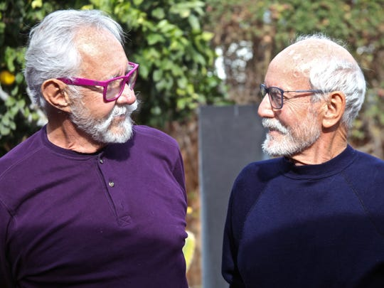 Donald Beck (left) and his partner Geoffrey Webb (right) chat at the backyard of their home in Palm Springs on Wednesday, Dec. 9, 2015.