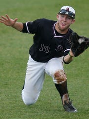 Appoquninimk's Joseph Otto slides for a catch in the fourth inning of Appoquinimink's 10-2 win over Cape Henlopen to give the Jaguars their first state title in any sport Saturday at Frawley Stadium.