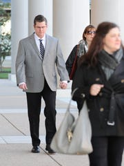 Former Dover Police officer Cpl. Thomas Webster walking to the Kent County Courthouse in December 2015.