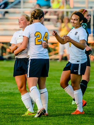 Lily Stephan ,24, of DeWit is congratulated by teammates after scoring to put the Panthers up 2-0 early in the 2nd half of their CAAC Gold Cup championship game with Williamston Tuesday May 24, 2016 in Eaton Rapids.  KEVIN W. FOWLER PHOTO