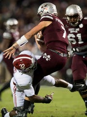 Alabama linebacker Rashaan Evans (32) sacks Mississippi