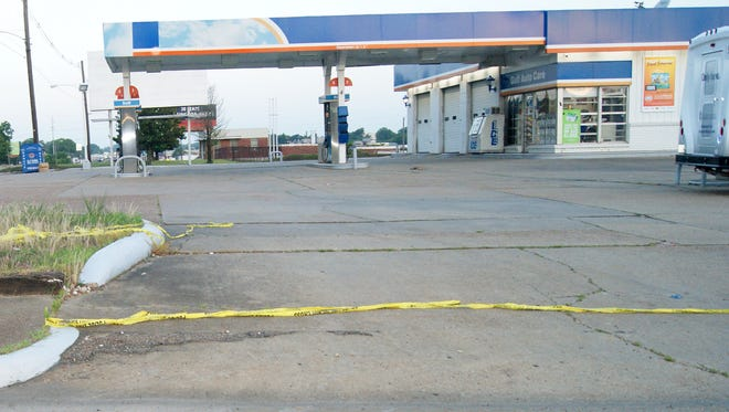 Crime scene tape is seen the morning after a murder at the Gulf gas station on Woodrow Wilson Avenue in Jackson, Miss.