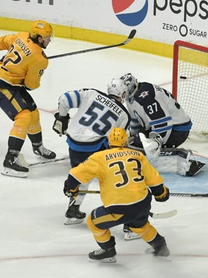The shot by Predators center Ryan Johansen (92) sails over Jets goalie Connor Hellebuyck (37) into the net during the third period in Game 2 of the second round NHL Stanley Cup Playoffs at the Bridgestone Arena Monday, April 30, 2018, in Nashville, Tenn.