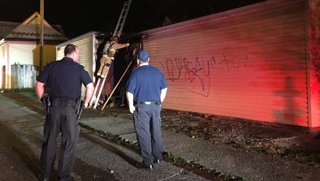 The Richmond Fire Department is investigating a suspicious fire at a garage behind 211 N. 14th St. Wednesday night.